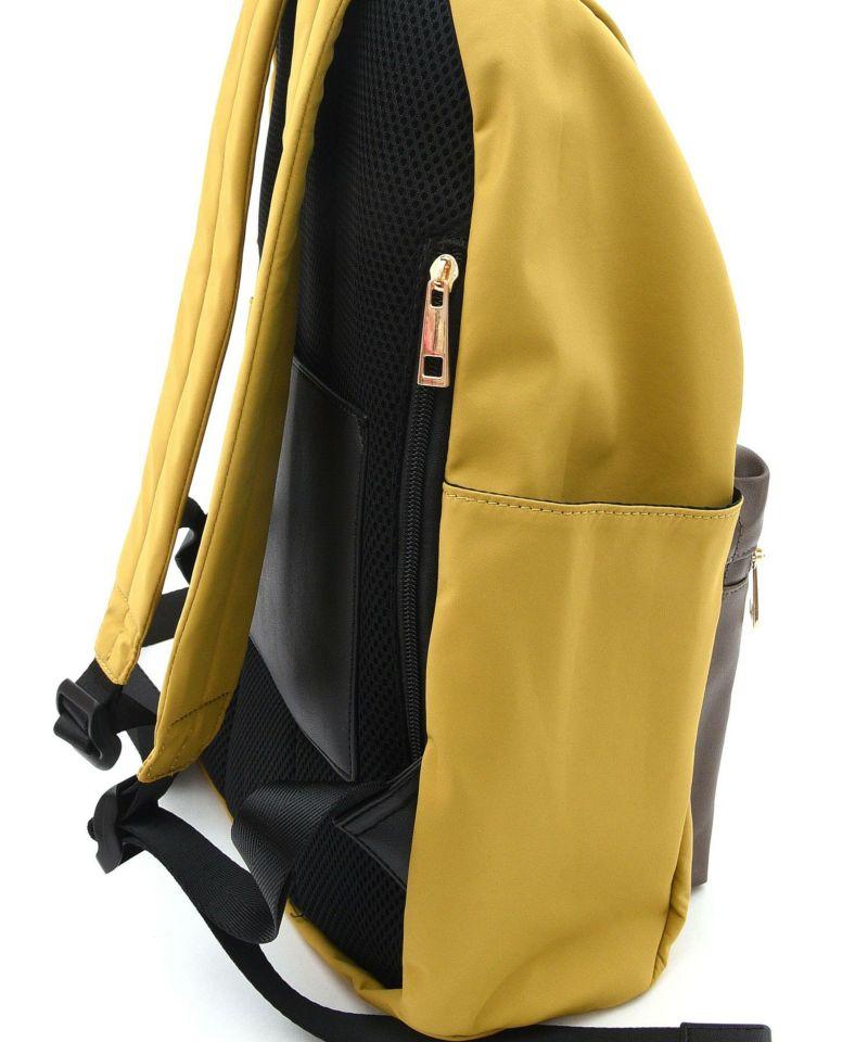 背面ファスナー付きで背負ったままでも取り出し可能です。